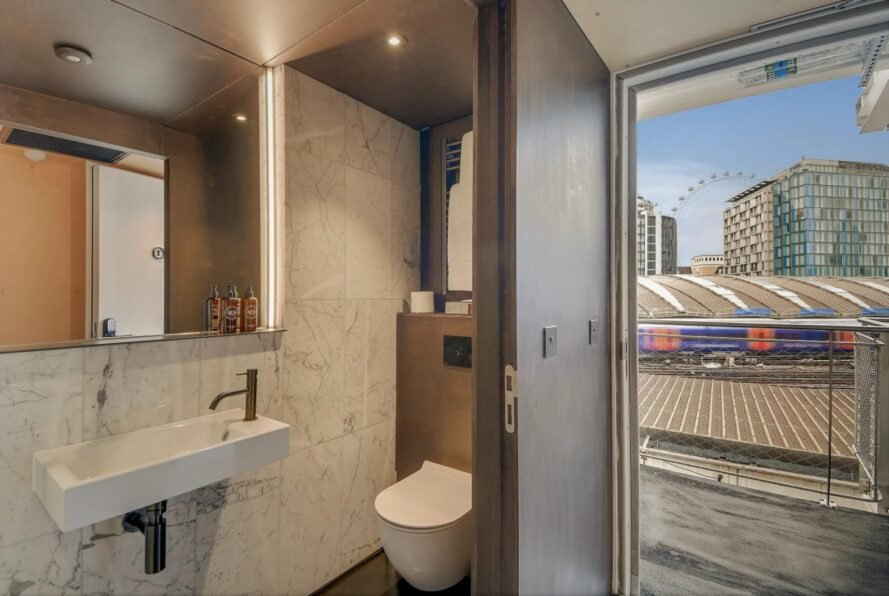 compact, modern bathroom inside hotel