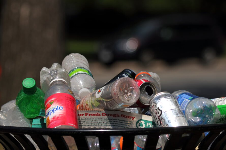aluminum cans and plastic bottles in the garbage
