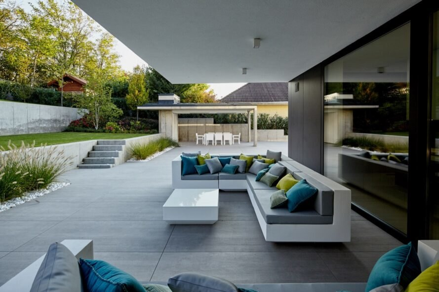 outdoor deck with white and gray sofa