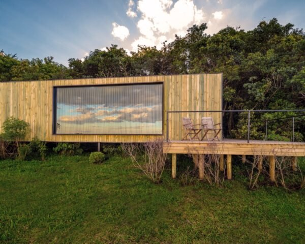 wood-covered shipping container with long rectangular window