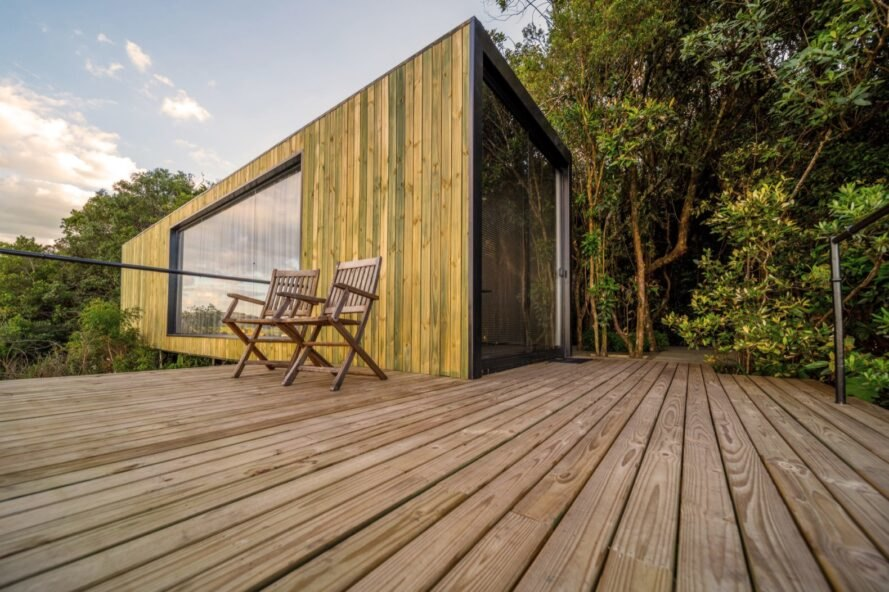 wood deck connected to shipping container with wood facade