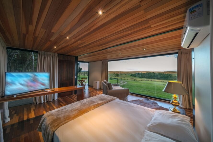 bed in wood-lined room