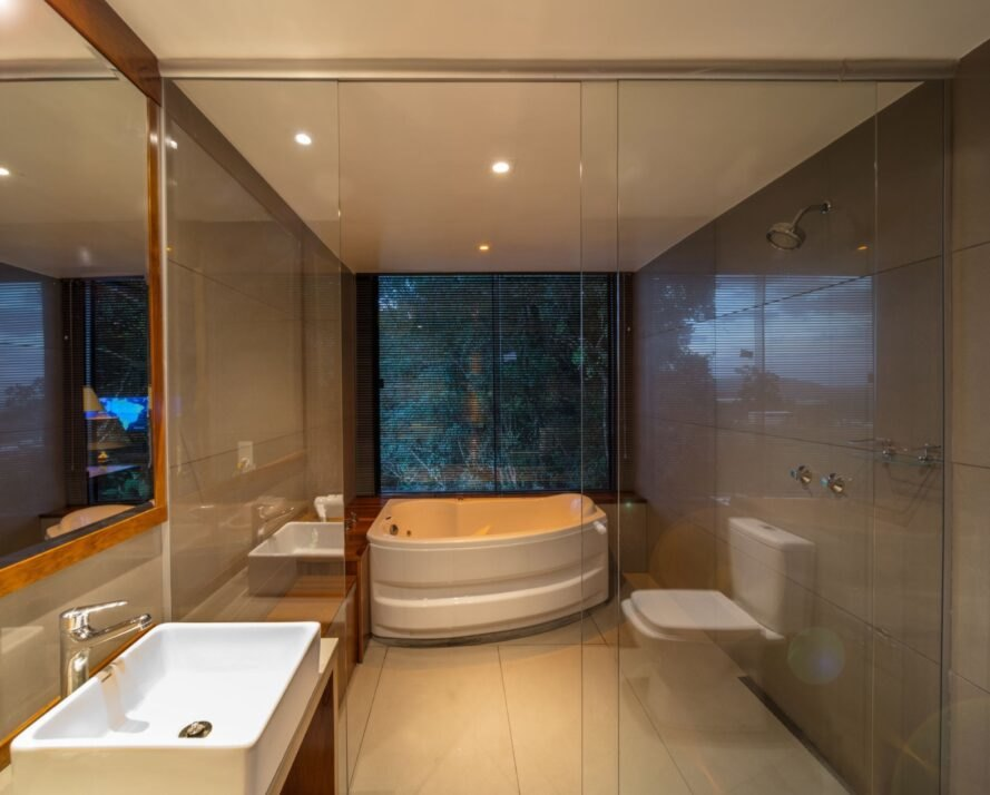 modern, dark bathroom with spa tub