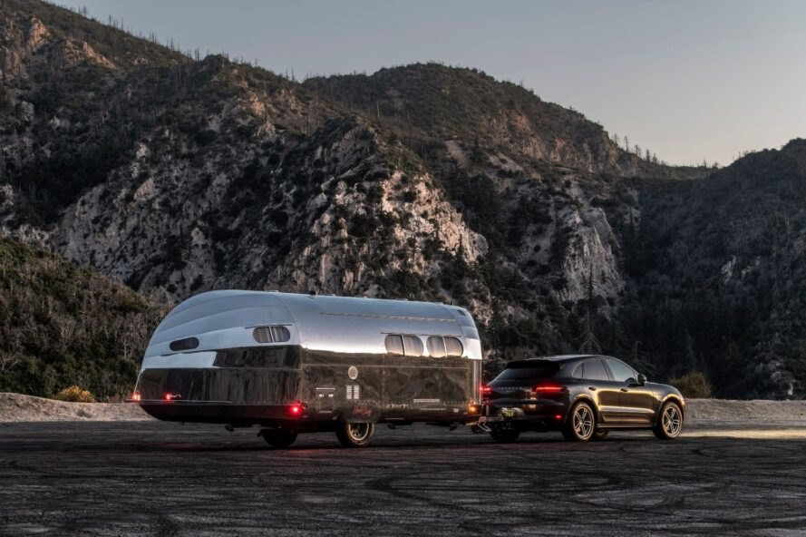 SUV pulling a metal-clad travel trailer