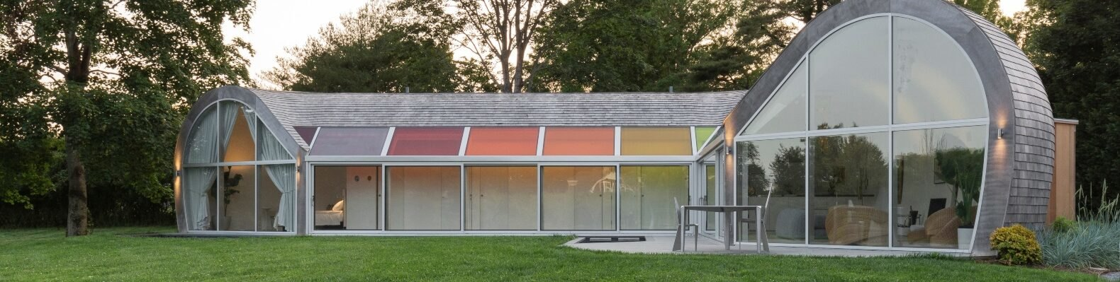 curved home with multicolored skylights