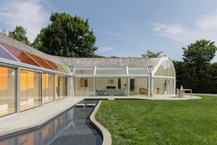 curved home with glass walls