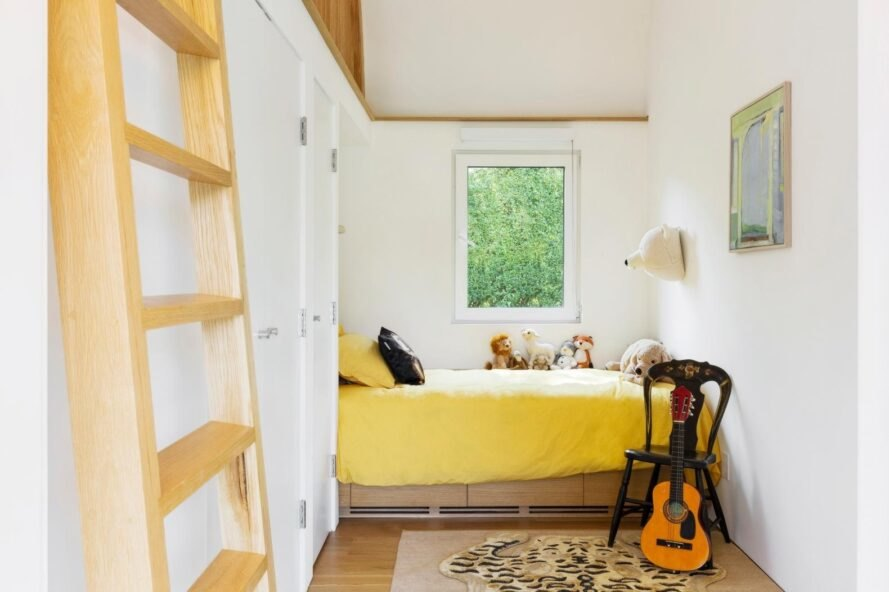 bedroom with yellow bed and a guitar