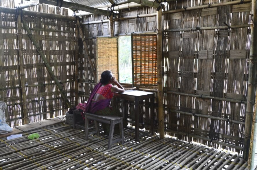 person at desk in a bamboo room