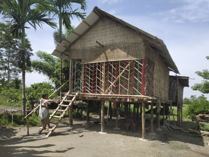 people building gabled house with bamboo