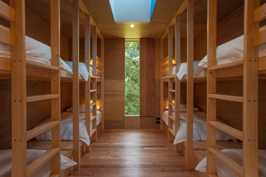 rows of wood bunk beds