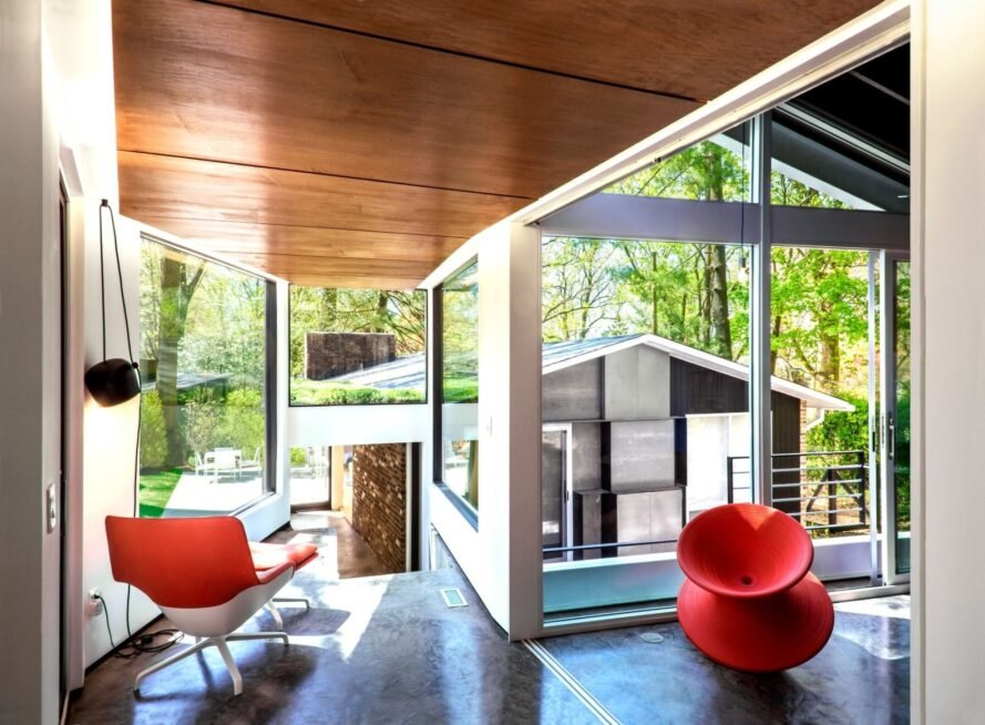 interior living space with floor-to-ceiling windows and red chairs