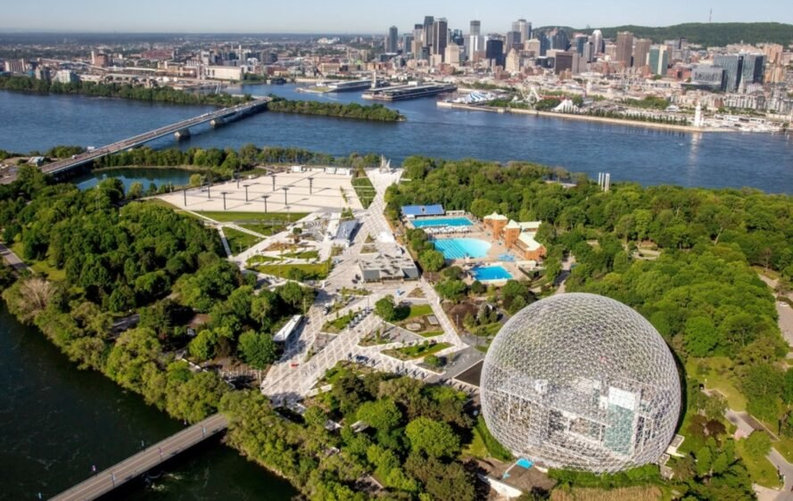 aerial view of geodesic dome pavilion and park near waterway