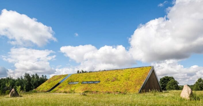 Stunning green-roofed home in Poland is embedded into the idyllic