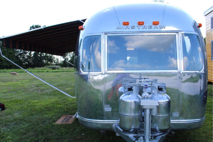 silver Airstream with extended shade