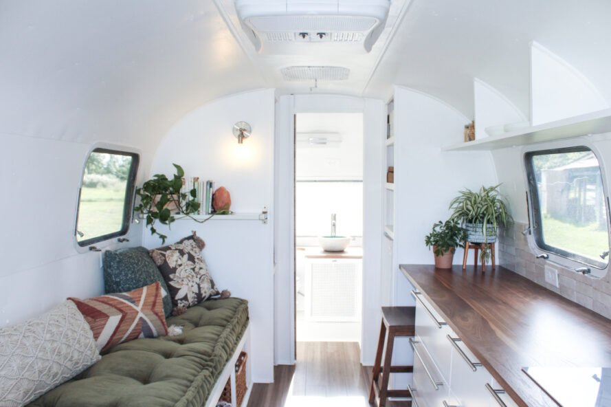 white and olive-green living area in an Airstream