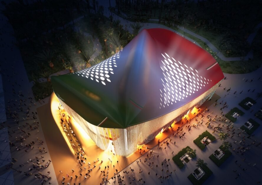 aerial view of curvy pavilion with red, white and green roof