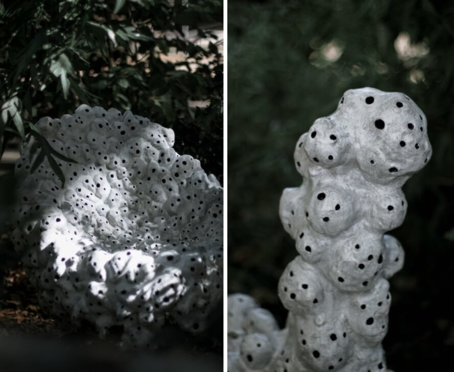 white sculptures with holes in nature