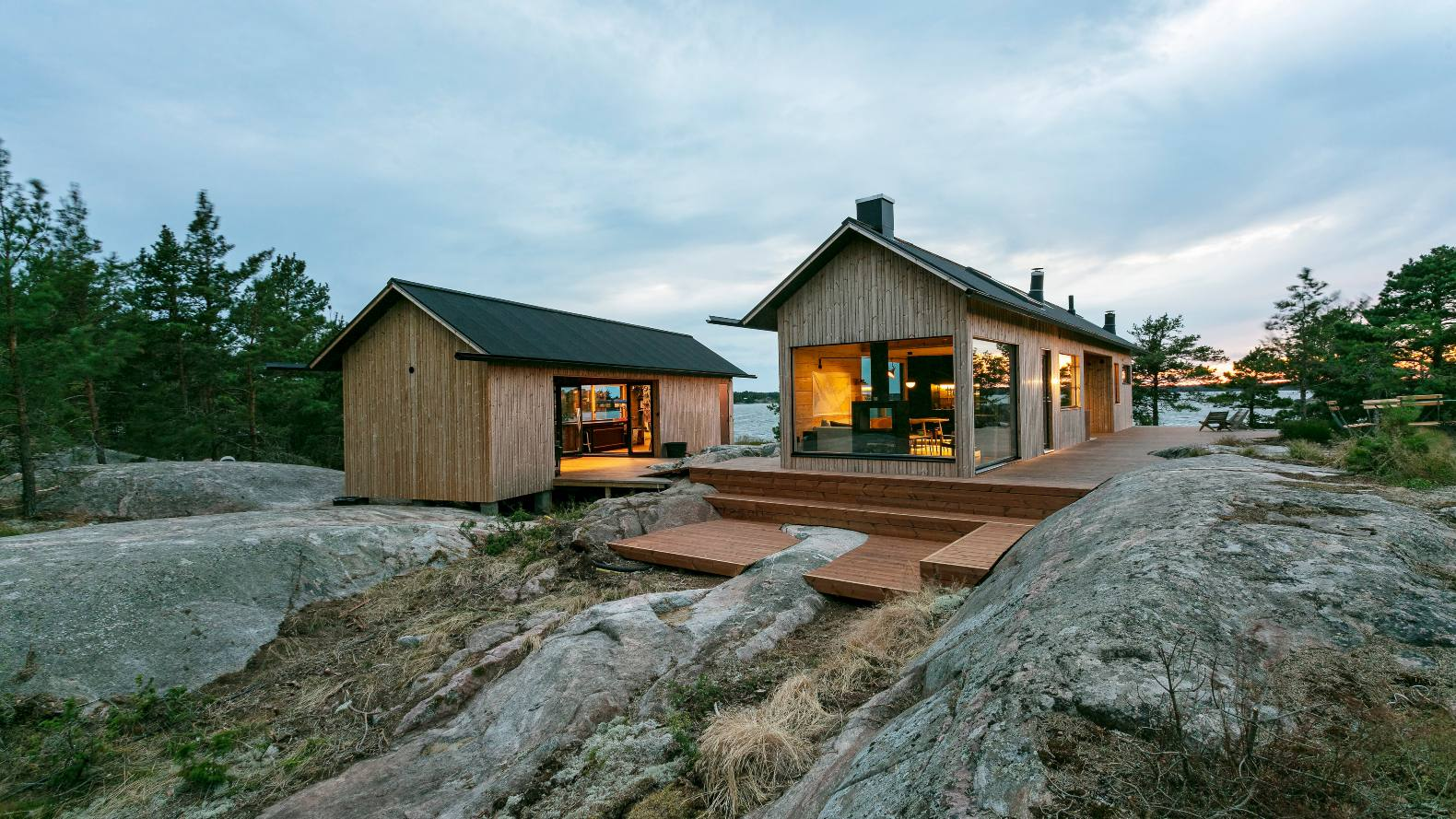 Two beautiful, self-sustaining tiny cabins rest on a remote island