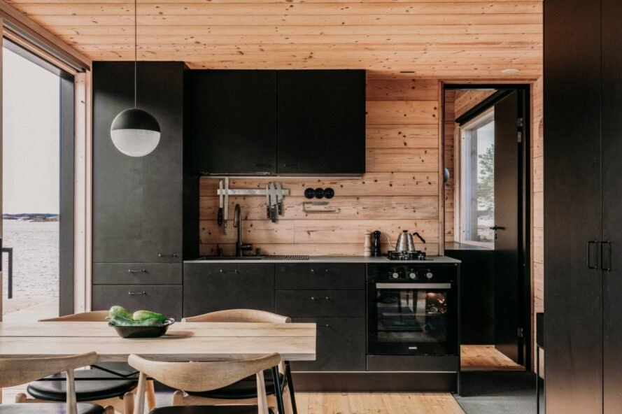 wood table and black kitchen