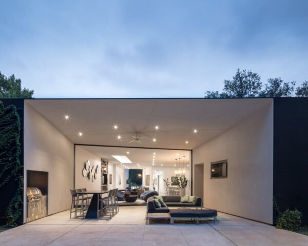 outdoor seating area in front of black and white home
