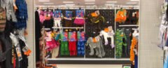 Department store aisle with Halloween decorations and costumes prominently displayed