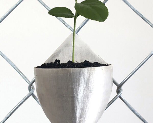 recycled plastic plant pods on chain link fence