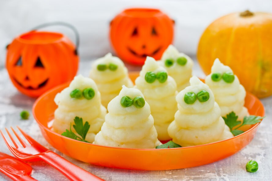 piles of mashed potatoes to look like ghosts with two eyes made from peas