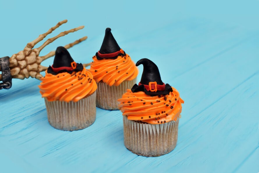 cupcakes with orange frosting and witch hats