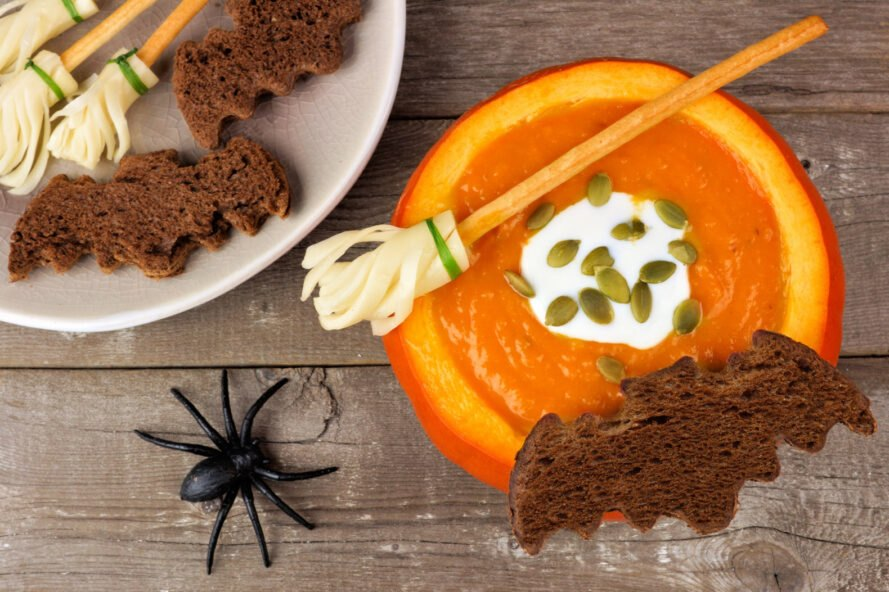 pumpkin soup in a pumpkin with bat-shaped bread
