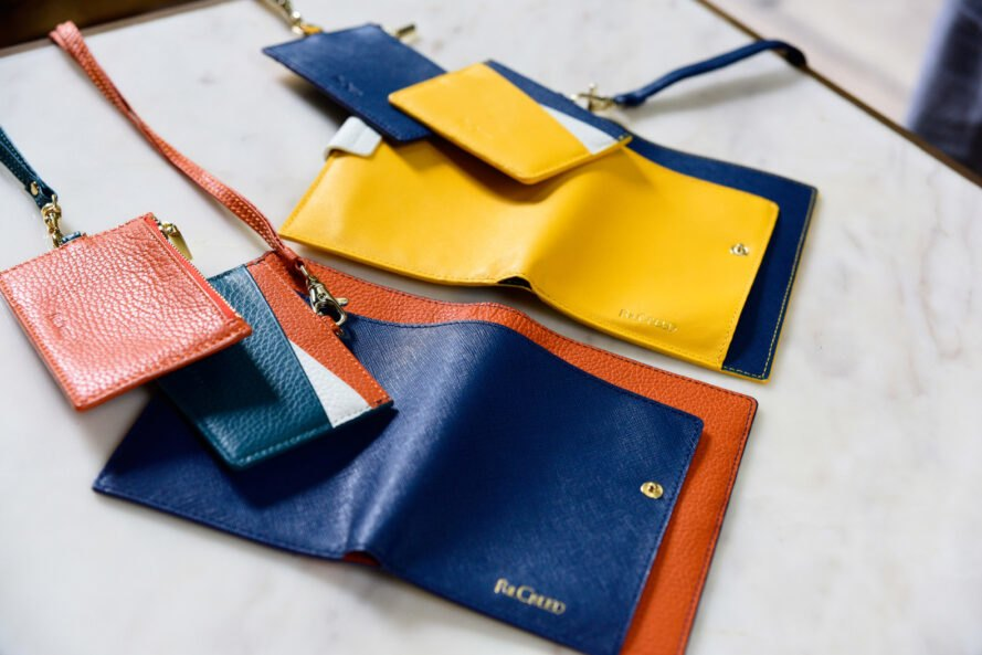colorful passport holders and wallets on a table