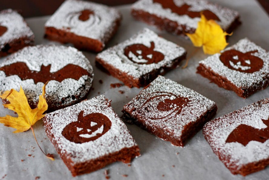 brownies with powdered sugar and Halloween shapes like pumpkins, bats and spiders