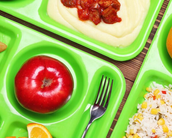 lunch items on green trays