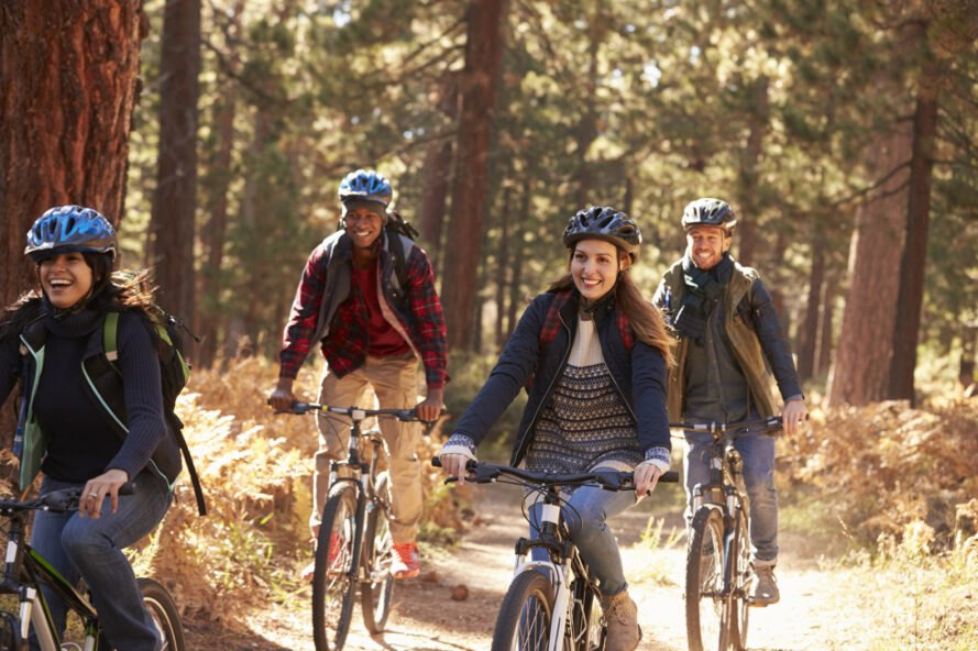group of people riding bikes in the fall