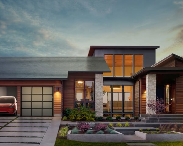 rendering of home with Tesla solar roof tiles