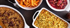 All traditional Thanksgiving side dishes, roasted carrots, sweet potato casserole, cranberry sauce and stuffing