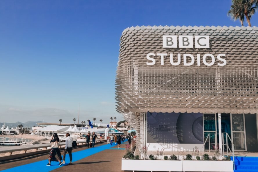 "aluminum pavilion with sign that reads ""BBC Studios"""
