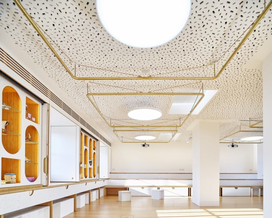 large white room with gold ceiling details