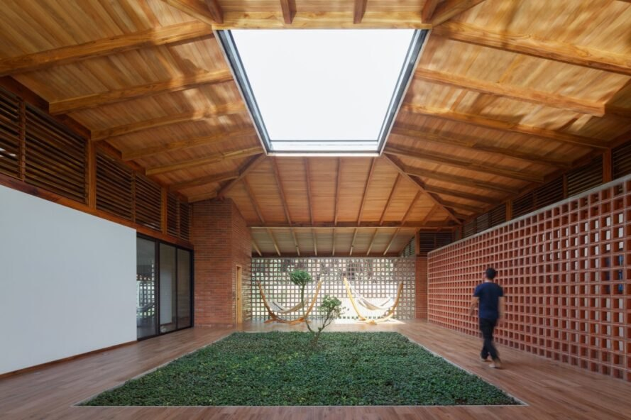 wooden home with courtyard and large skylight