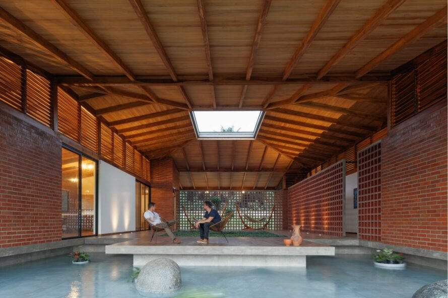 pool under a wood roof with a skylight