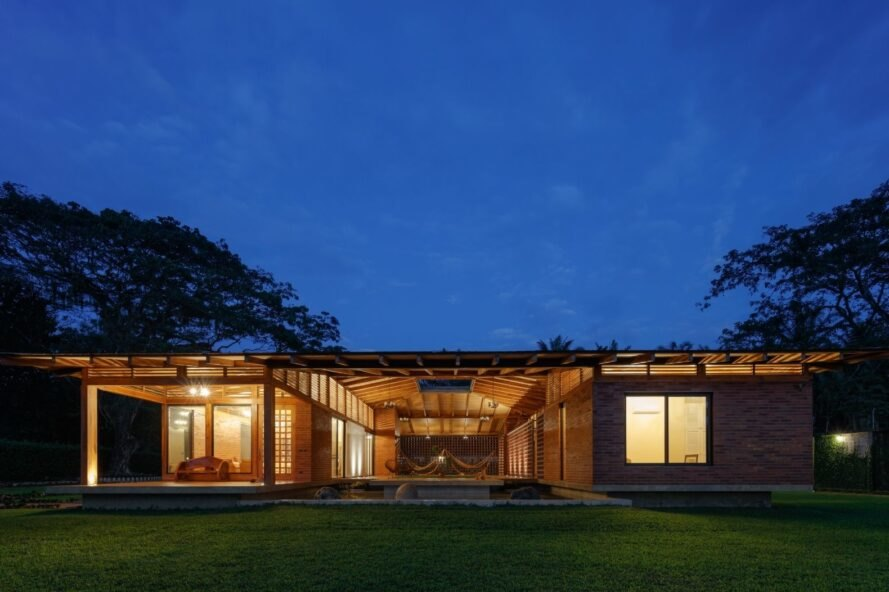 single-story home with large courtyard at night