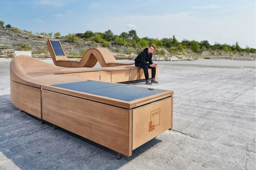 curvaceous wooden lounge chair with solar panels