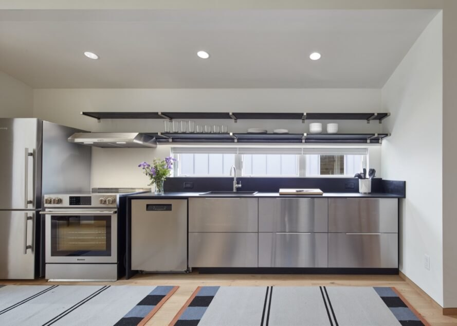 blue and gray kitchen with steel appliances
