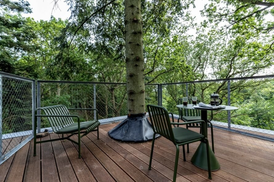 open-air deck with tree growing out of it