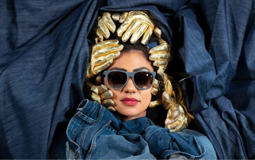 woman wearing denim sunglasses