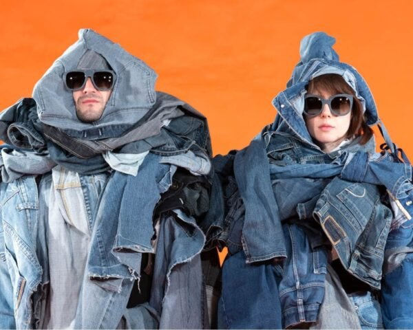 couple wearing denim sunglasses and layers of denim clothes