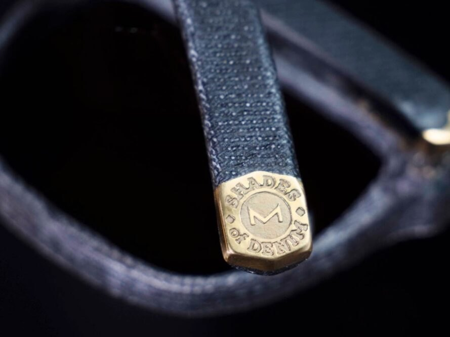 brass detail on denim sunglasses
