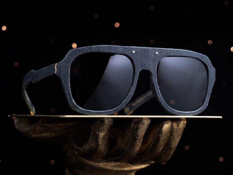 denim sunglasses on a stand