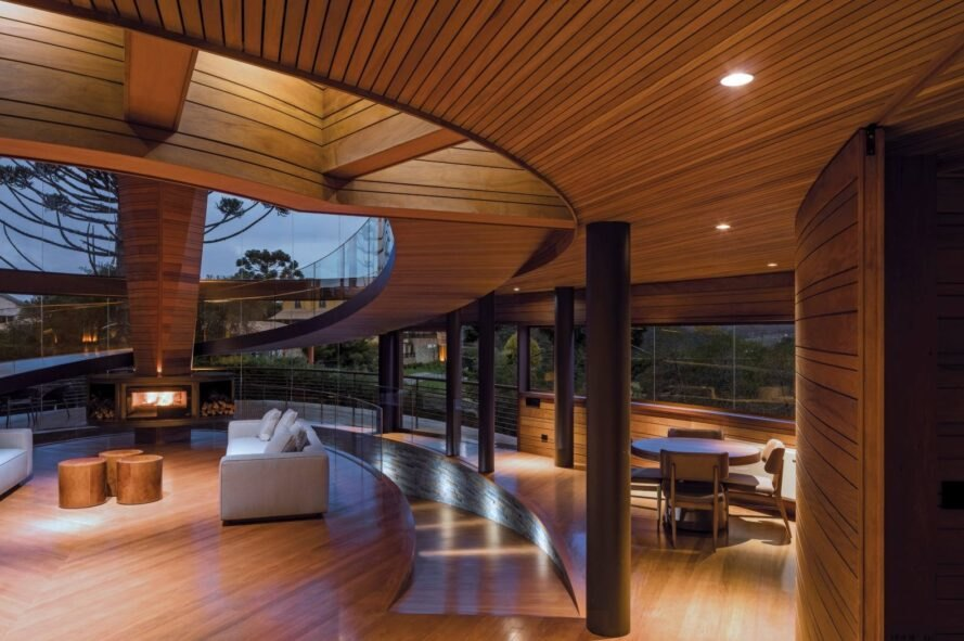 wood-lined living room with curving walls