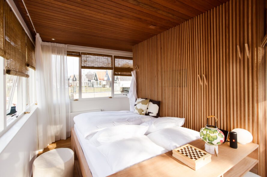 hotel room with plywood walls