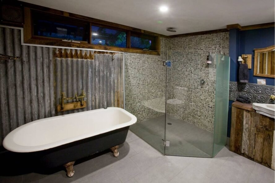 large bathroom with claw-foot bathtub and glass-enclosed shower